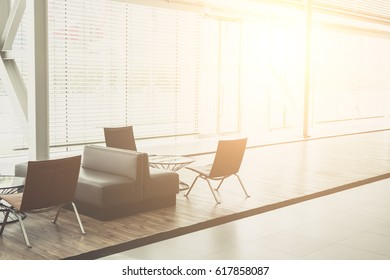 Sofa and spacious and modern waiting room at office