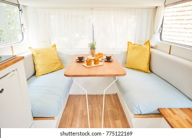 sofa and table in vintage caravan(retro design camper)