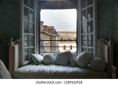 Sofa and view from a penthouse window in Bretagne, France