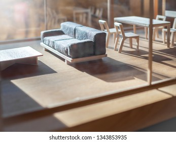 Sofa and wooden table set in living room balsa wood model. Miniature room model interior.