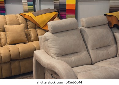 Sofas and upholstery samples in the exhibition hall. Sale