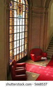 Sofas in waiting area with stained glass window