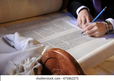 Sofer finishing the final letters of a sefer Torah. In the Torah's 613 commandments, the second to last is that every Jew should write a Sefer Torah in their lifetime.
