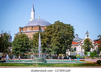 SOFIA, BULGARIA - 1 Sep 2018: View of Banya Bashi, ornate mosque with a large dome built over thermal spas during the 16th-century Ottoman Empire, from Banski square in Sofia