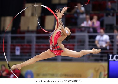 Sofia, Bulgaria - 14 September, 2018: Linoy ASHRAM from Israel performs with ribbon during The 2018 Rhythmic Gymnastics World Championships. Individual tournament.