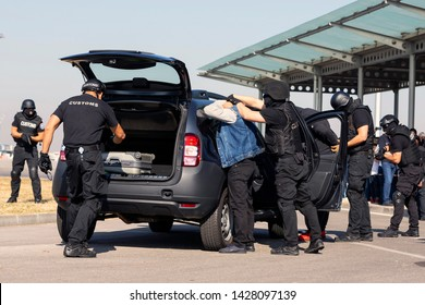 Sofia, Bulgaria - 17 October 2018: Customs and border protection officers and Drug enforcement administration special forces participate in a training at the airport for searching and seizing drugs.