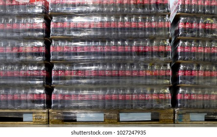 Sofia, Bulgaria - 19 December 2018: Packed Coca Cola bottles in plastic foil on pallets in a warehouse.