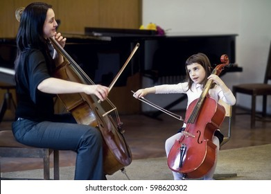 Sofia, Bulgaria - 27 May, 2012:  Musician teaches small girl how to play cello