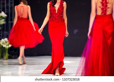 Sofia, Bulgaria - 28 March 2018: Female models walk the runway in red dresses during a Fashion Show. Fashion catwalk event showing new collection of clothes.