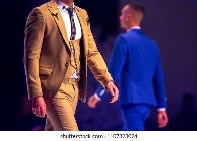 Sofia, Bulgaria - 28 March 2018: Male model walks the runway in beige suit during a Fashion Show. Fashion catwalk event showing new collection of clothes.