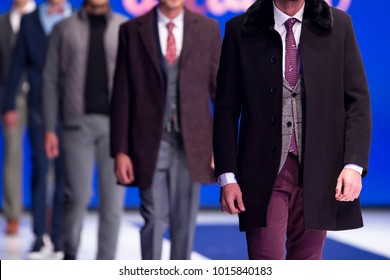 Sofia, Bulgaria - 28 September 2017: Male models walk the runway in stylish suits during a Fashion Show. Fashion catwalk event showing new collection of clothes. Single model.