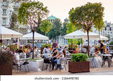 SOFIA, BULGARIA - 29 August 2018: An outdoors restaurant in Sofia in the warm summer evening