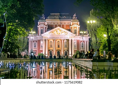 SOFIA, BULGARIA - 31 Aug 2018: Ivan Vazov National Theatre and the square with the fountain before it at night