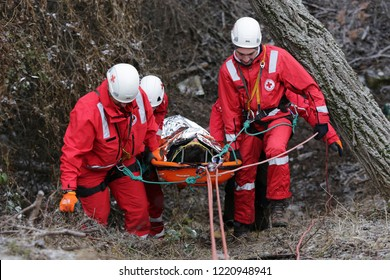Sofia, Bulgaria - 5 December 2017: Paramedics from mountain rescue service provide first aid during a training for saving a person in accident in the forest.