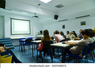 Sofia, Bulgaria - 7.16.13: Small hall with students sitting on desks, watching technology lecture, projected on a special board.