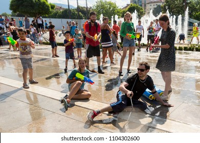 Sofia, Bulgaria - 8 July 2017: Children and adults participate in a fight with water guns and other water spray equipment in the center of Sofia.