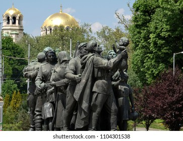 SOFIA, BULGARIA, APRIL 26 2018:  Red army monument with the Cathedral of Saint Alexandar Nevski in the background in Sofia