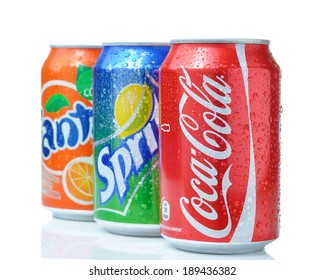 SOFIA, BULGARIA - APRIL 27, 2013: Coca-Cola, Fanta and Sprite Cans Isolated On White. The three drinks produced by the Coca-Cola Company