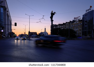 SOFIA, BULGARIA - AUGUST 02, 2017: silhouette monument of Saint Sophia and cars light on the crossroad in Sofia downtown at the sunset