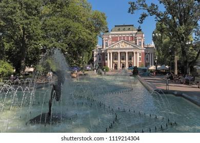 SOFIA, BULGARIA - AUGUST 02, 2017: the Ivan Vazov National Theatre and water jets of the fountain in front