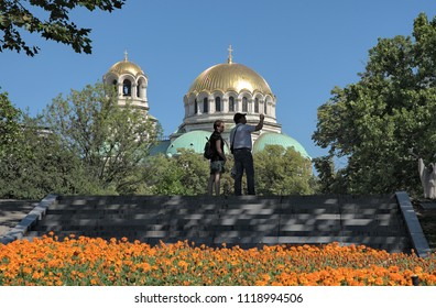 SOFIA, BULGARIA - AUGUST 03, 2017: couple of tourists take pictures in front of Alexander Nevsky Cathedral