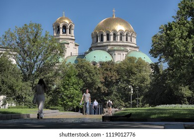 SOFIA, BULGARIA - AUGUST 03, 2017: the Alexander Nevsky Cathedral dominates the trees of surrounding parks traveled by people and tourists