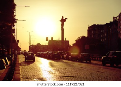SOFIA, BULGARIA - AUGUST 04, 2017: silhouette monument of Saint Sophia and cars light on the crossroad in Sofia downtown at the sunset
