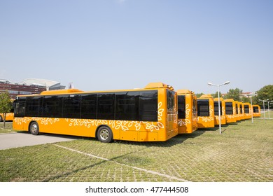 Sofia, Bulgaria - August 31, 2016: New modern busses for public transportation are shown in a row from the backs in a parking lot.