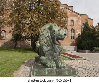 SOFIA, BULGARIA - AUTUMN 06, 2017: monument to lion on memorial to soldiers, died for liberation of Bulgaria and  Saint Sofia church of IV century.
