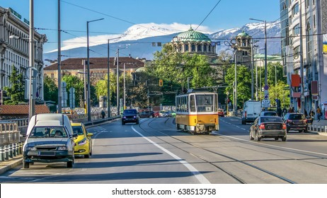 "Sofia, Bulgaria The church ""Sveta Nedelya"" cathedral of the Sofia bishopric. Traffic Boulevard Knyaginya Mariya Luiza, in the background the Vitosha Mountain. Sofia. Bulgaria"