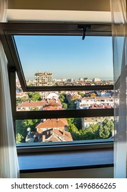 Sofia, Bulgaria. A dangerous and high risk hotel window with a mid-point hinge. It opens wide enough to allow an adult or child to easily fall. The view looks out over roof tops nine storeys below.