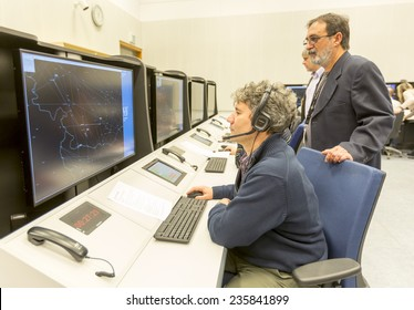 """Sofia, Bulgaria - December 2, 2014: Air Traffic Controllers at the """"Bulgarian Air Traffic Services Authority"""" (BULATSA) control center are operating on their work places."""