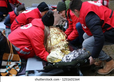 Sofia, Bulgaria - December 5, 2018: Volunteers from the organization of the Bulgarian Red Cross participate in training with a fire service. They help provide first aid to people after an earthquake