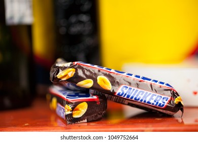 SOFIA, BULGARIA - FEBRUARY 28, 2018:Snickers chocolate bar isolated on white background. Snickers bars are produced by Mars Incorporated. Snickers was created by Franklin Clarence Mars in 1930