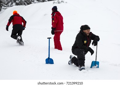 Sofia, Bulgaria - January 18, 2017: Rescuers from Mountain rescue service at Red Cross organization participate in a training for finding people buried in an avalanche under the snow.