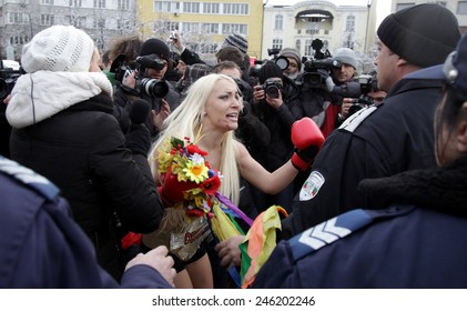 SOFIA, BULGARIA - JANUARY 21, 2012: Activists from Ukrainian feminist group FEMEN shout slogans during a topless protest in front of Bulgaria's Parliament building on January 21, 2012, in Sofia.