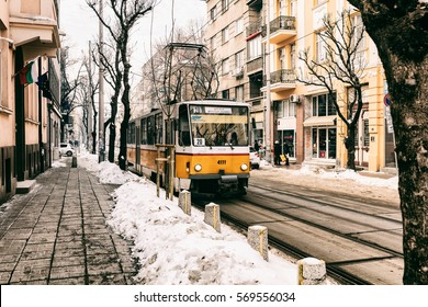 Sofia, Bulgaria - January 29, 2017: Tram in a city centre street, during winter snow.