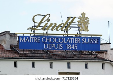 Sofia, Bulgaria - July 04, 2017: Advertisement of Chocolats Lindt on a building rooftop. Lindt is a brand of the Lindt & Sprungli AG - a Swiss company, founded in 1845.