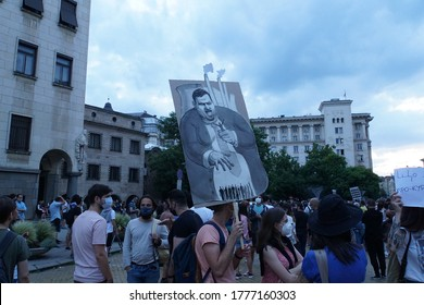 Sofia / Bulgaria - July 14 2020: Protesters hold a poster with the symbol of the Bulgarian oligarchy Delyan Peevski, who took over most of the country's businesses