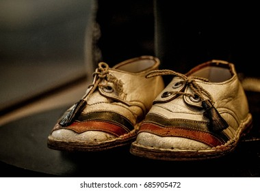 SOFIA, BULGARIA - July 16, 2017: The children's shoes of the last Bulgarian monarch Simeon II with the Bulgarian flag on them