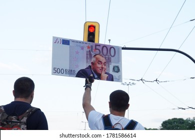 Sofia / Bulgaria - July 16 2020: Protesters with a poster of 500 euro banknote with the symbol of corruption in Bulgaria - Prime Minister Boyko Borissov