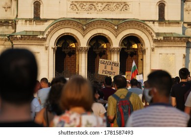 """Sofia / Bulgaria - July 16 2020: Crowd of protesters against corruption in Bulgaria and the Prime Minister Boyko Borissov, holding sign """"Bulgaria under renovation"""""""