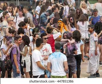 SOFIA, BULGARIA - July 2, 2016: Happy people during Festival of colours Holi behind Sofia Ring Mall, Sofia, Bulgaria