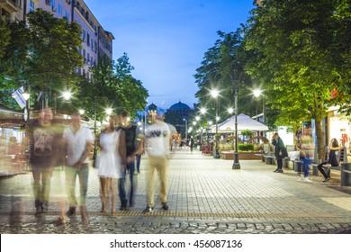 Sofia, Bulgaria - Jun 28, 2016:  Young people walking trough Vitosha boulevard after a hot summer day in Bulgarias capital city