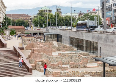 SOFIA, BULGARIA - JUNE 26: Tourists exploring ancient remains of Serdica Archaeological Complex in Sofia, Bulgaria on June 26, 2018.