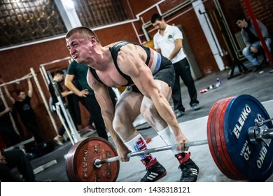 Sofia, Bulgaria - Mart 23, 2019: Young, muscular and very strong Bulgarian power-lifter is making successful deadlift attempt at Bulgarian National Powerlifting Championship Competition.