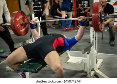 Sofia, Bulgaria - Mart 23, 2019: Very strong Bulgarian power-lifter is making successful bench-press attempt at Bulgarian National Powerlifting Championship Competition.