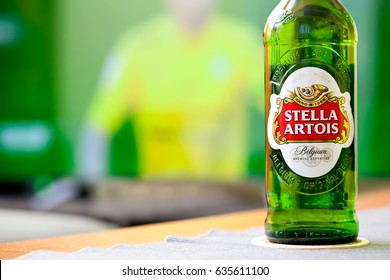 SOFIA, BULGARIA - MAY 08, 2017: Cold Bottle of Stella Artois beer on tv background, football time with beer concept