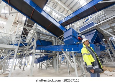 Sofia, Bulgaria - May 29, 2015: An engineer is keeping an eye on the testing of Sofia's second waste plant.