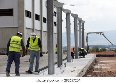 Sofia, Bulgaria - May 29, 2015: Workers are finalizing the construction of Sofia's second waste plant (organic waste plant, waste to energy, composting, incineration, landfill, recycling, windrow).